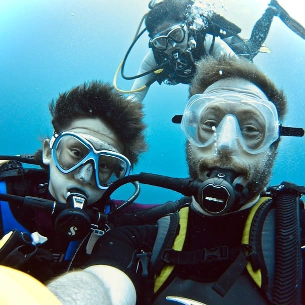 Kris Holden-Ried scuba diving with his son