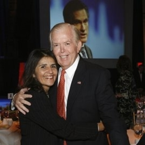 Debi and Lou Dobbs hugging each other while having a photo session
